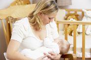 Mother Breastfeeding Baby In Nursery