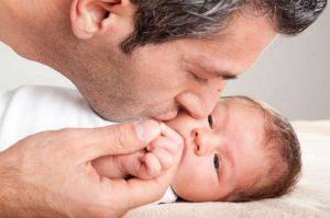 father_kissing_baby_boy_436169622_154338